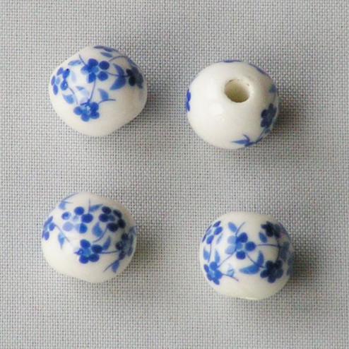 Porseleinen kraal, rond, 10 mm,  koningsblauw-wit, per 50 stuks